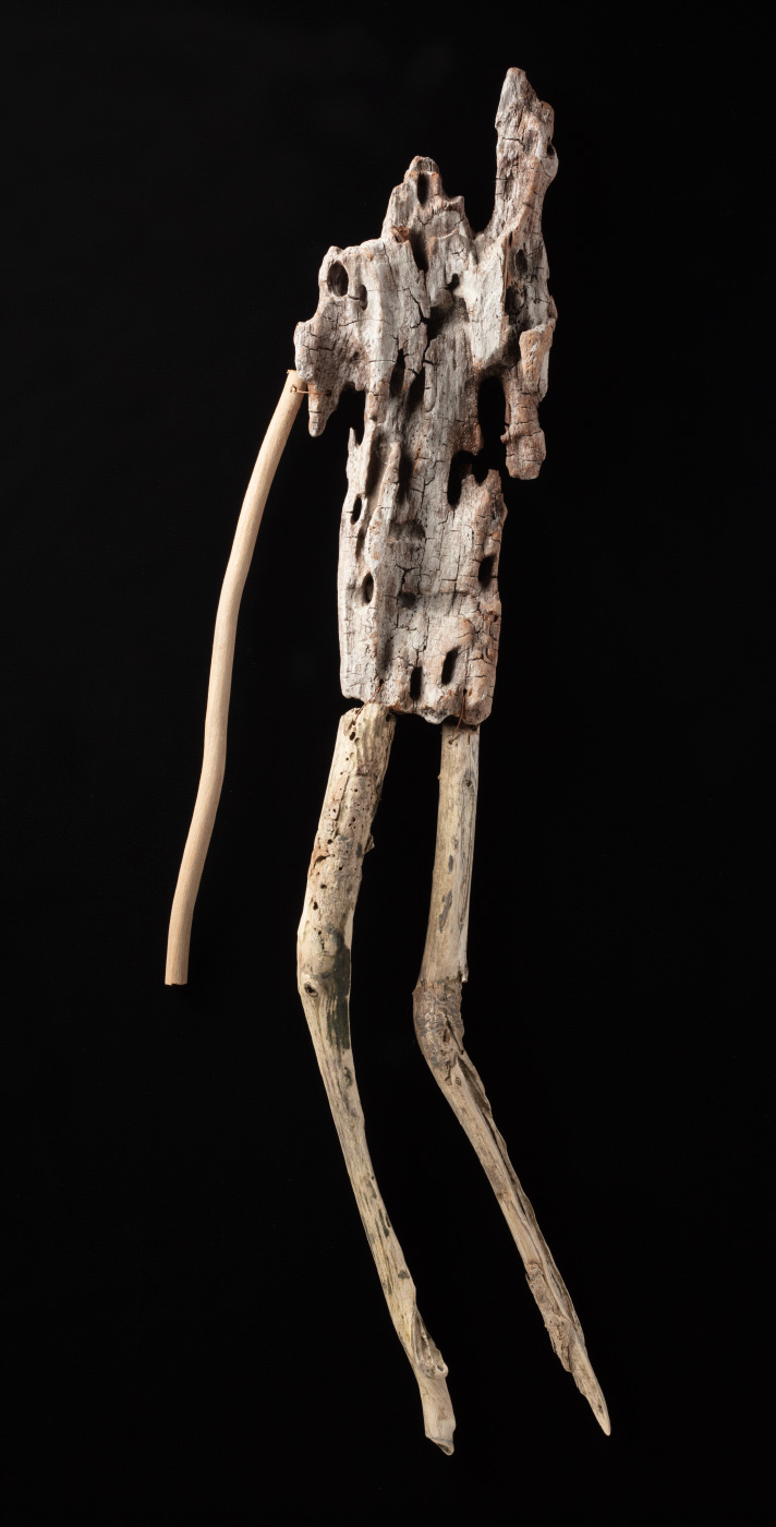 A figurative artwork made from driftwood and copper wire. - click to view larger image