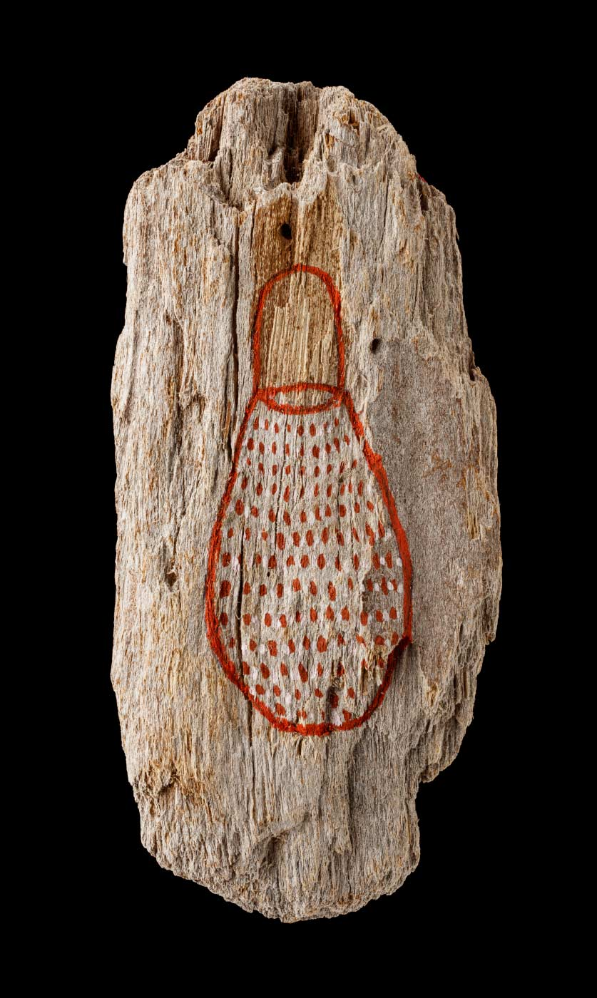 An acrylic painting on driftwood featuring a red/brown bag with red/brown and white dots. - click to view larger image