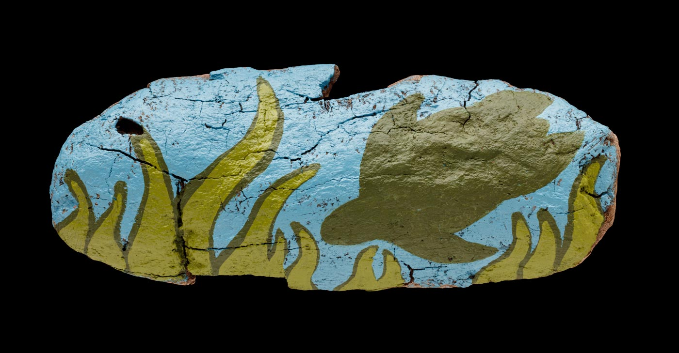 An acrylic painting on driftwood featuring a green sea turtle and seaweed. - click to view larger image
