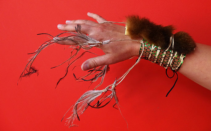 A bracelet made with fur and feathers.