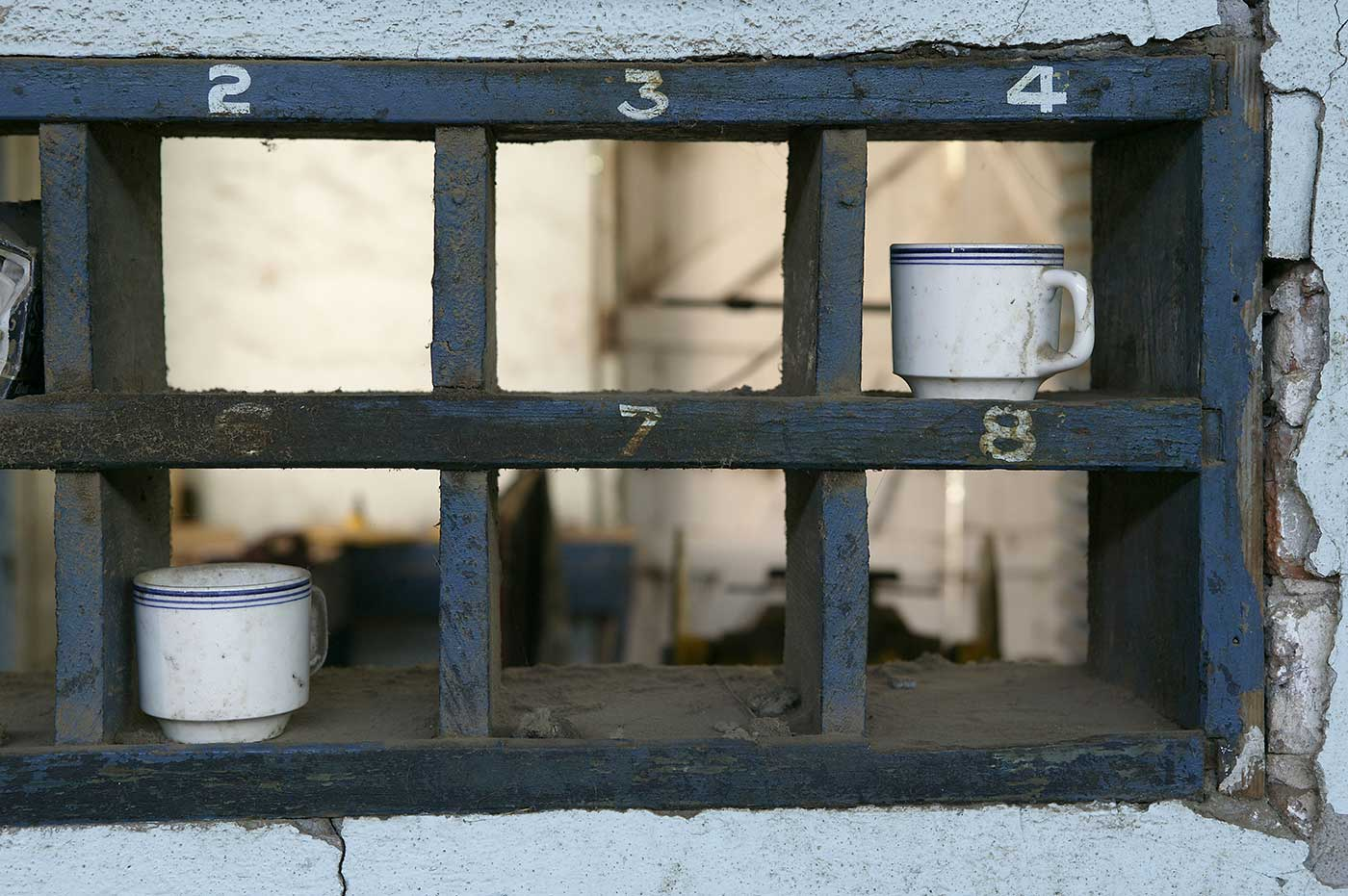 Numbered wooden shelves for drinking cups. - click to view larger image