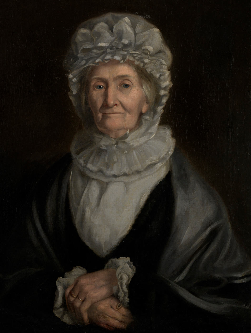 Painting of an elderly woman wearing 19th Century clothing including a frilled bonnet. - click to view larger image