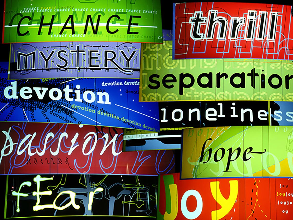 Montage of neon signs with text in various colours and fonts reading: 'chance, thrill, mystery, devotion, fear, separation, joy, loneliness, hope, passion'. - click to view larger image