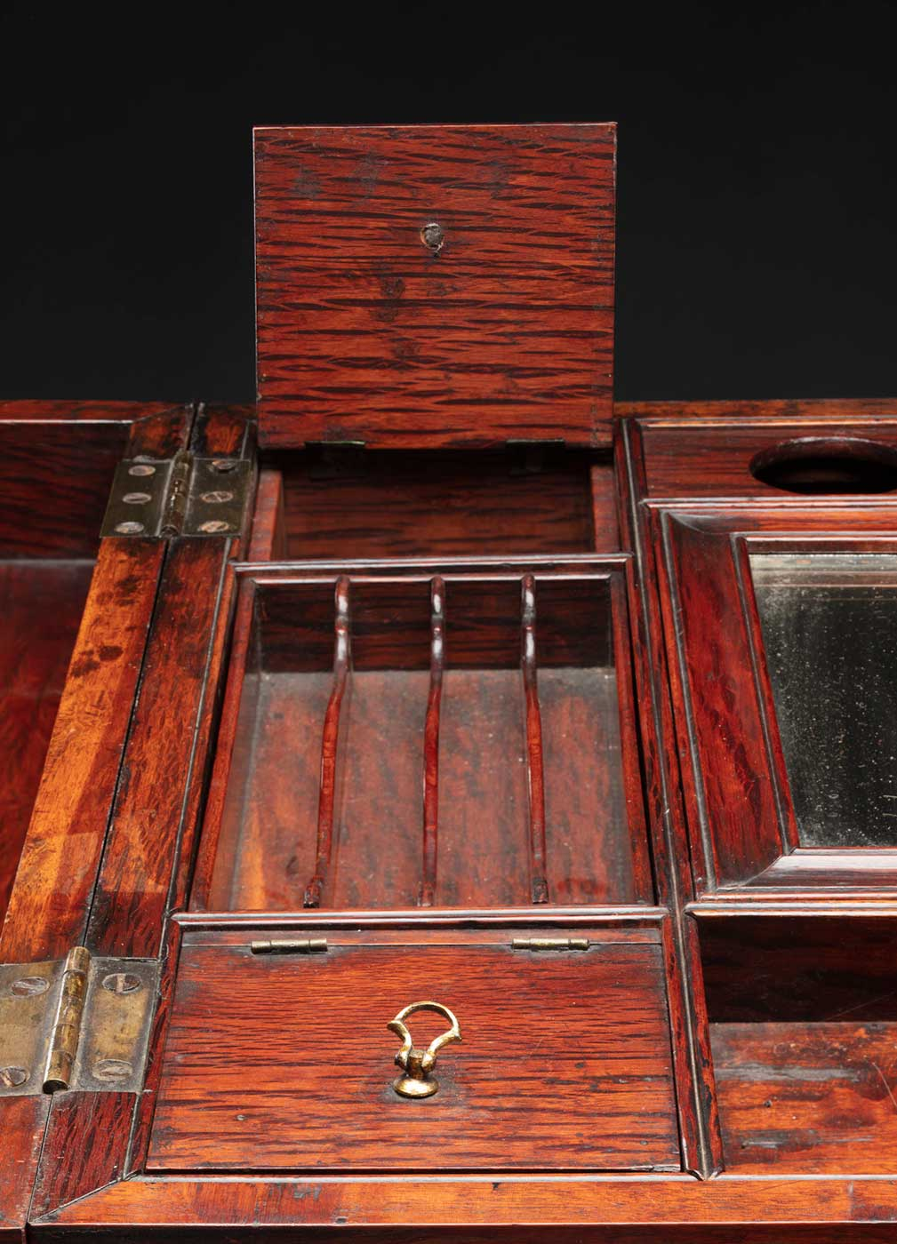 Detail of a wooden dresser table with multiple compartments. - click to view larger image