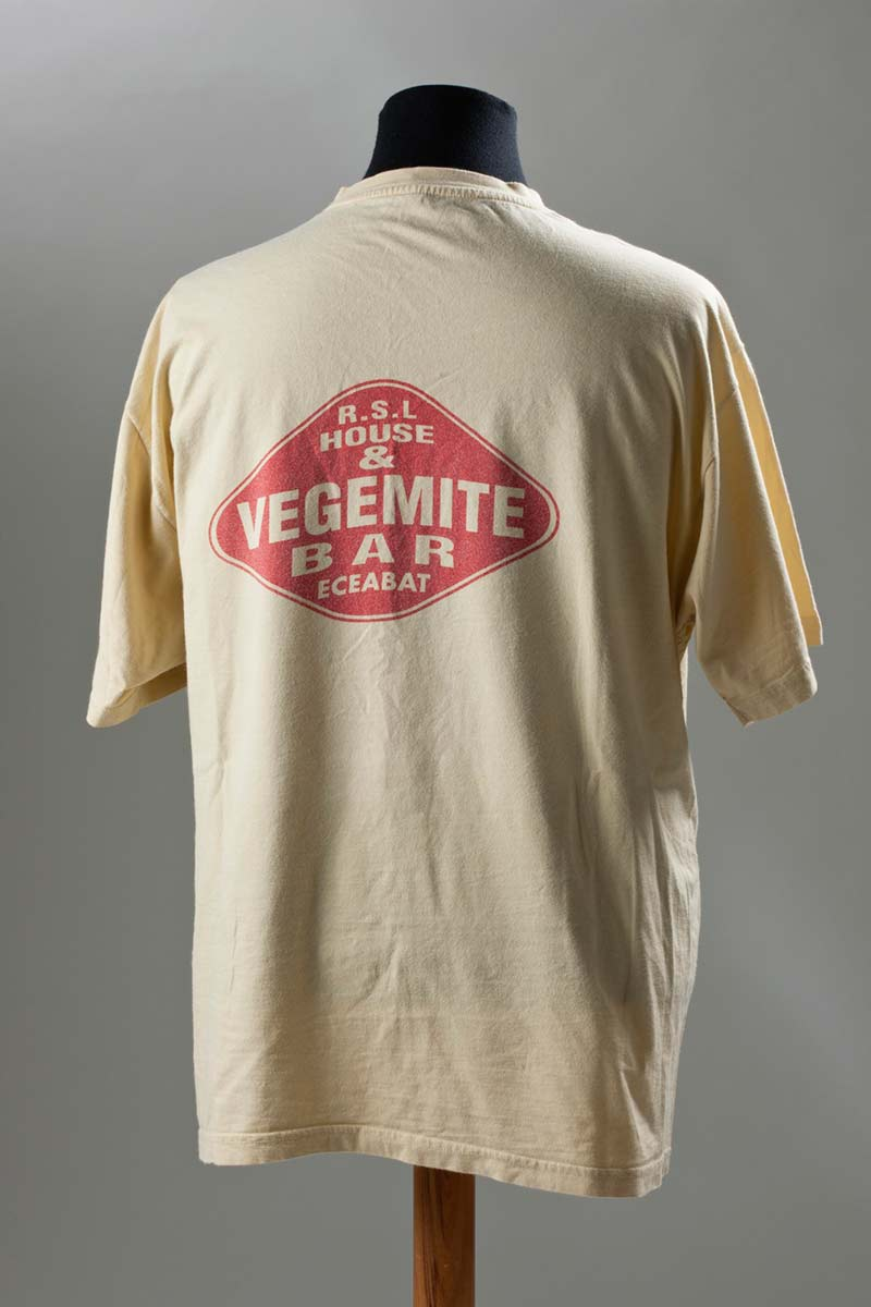 Pale yellow cotton t-shirt with 'Vegemite Bar' printed in red. - click to view larger image