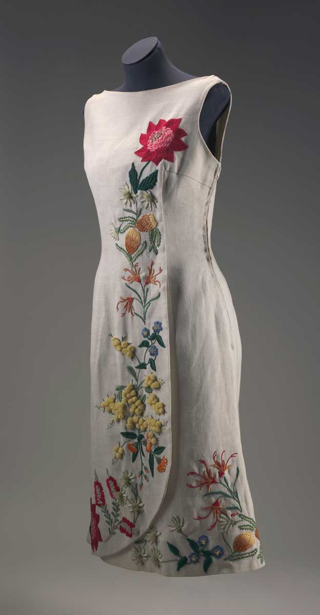 Beige linen sleeveless dress with Australian wildflowers embroidered down the front and around the hemline. - click to view larger image