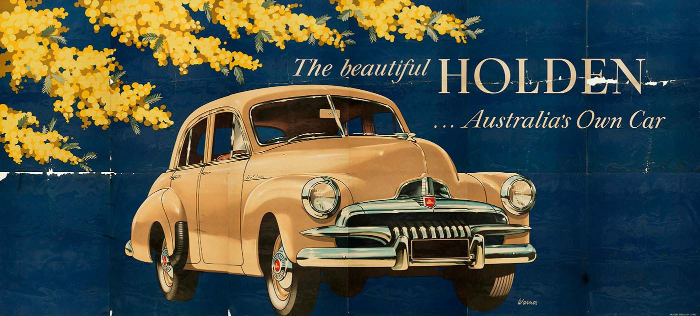 Billboard poster featuring a cream-coloured FJ Holden car in the centre and sprays of wattle in the top left corner. The text reads 'The beautiful HOLDEN ... Australia's Own Car'. - click to view larger image