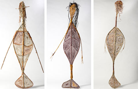 Three woven pandanus, mermaid-like Yawkyawk sculptures, by Kunwinjku artists (left) Marina Murdilnga and (centre and right) Lulu Laradjbi.