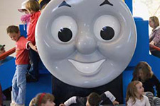 Young visitors climbing on a large Thomas the Tank Engine.