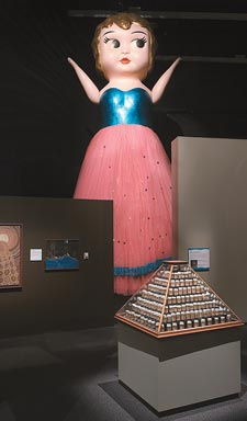 Betty, the giant Kewpie doll towering over the Captivating and Curious exhibition.