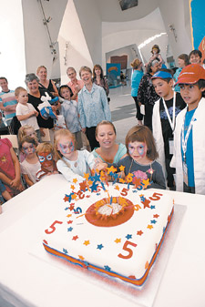 Visitors at the Museum celebrating its fifth birthday with cake and a few other five-year-olds.