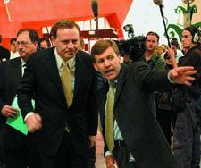Curator Guy Hansen guides the Treasurer Peter Costello to Cartoons 2002