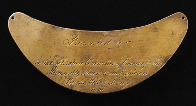 A breastplate inscribed with the word 'Presented to ... by the Exploration Committee of Victoria for the Humanity shewn to the Explorers Burke, Wills & King 1861'