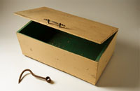 Detail of a wooden box and wharfies hook