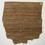 Thin double-layered barkcloth with black and brown lines are painted on to its grey surface.