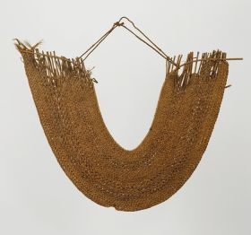 Horseshoe-shaped, collar-like breast ornament or gorget consisting of lattice-work made of some cane slips held together by twisted plant fibre strings.