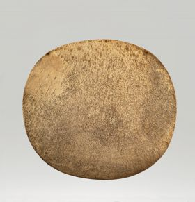 Breastplate made of whalebone. The surface is slightly round and curved, and polished on one side.
