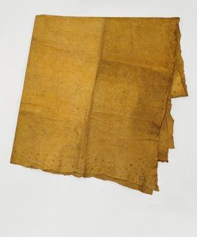 Thick double-layered barkcloth dyed a uniform yellow with pattern of two to four rows of red circles on the border.