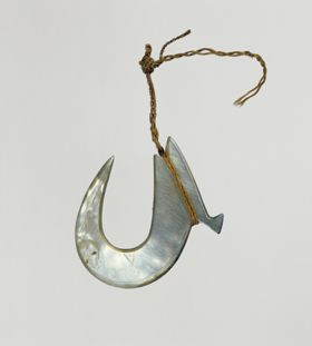 Fishhook made of mother-of-pearl, where strings made of various plant fibres are attached.