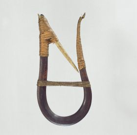U-shaped wooden hook made with whale sinew and an inward pointing barbed bone tied to the hook with root splits.