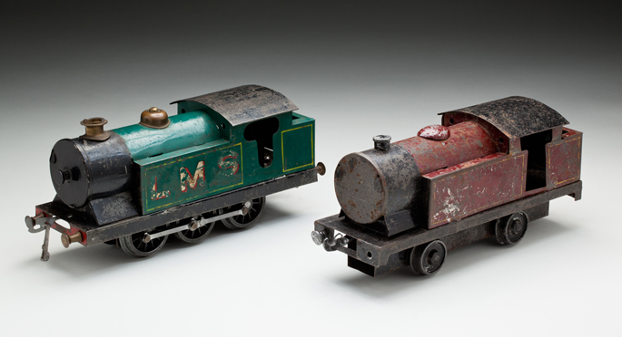 (l-r) Electrically driven and push along locomotives made with pressed and cast metals by Eric Hallmen in about 1945.