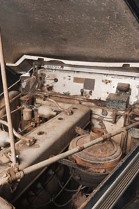 A photograph of the engine of an historic motor vehicle.