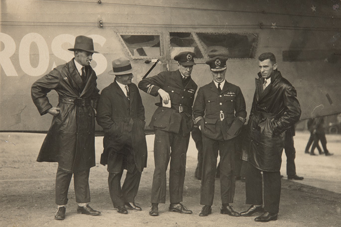 A black and white photo 'Southern Cross' aircraft with the crew standing in front of it.