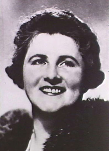 Black and white photo of smiling Dame Enid.