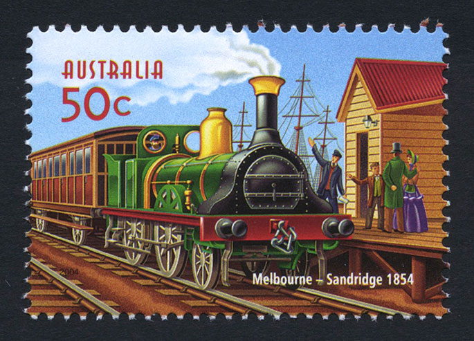 Colourful 50-cent stamp showing early steam engine at timber station with happy Victorian family on platform.