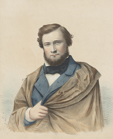 Colour image of bearded man wearing cloak concealing his missing left arm.