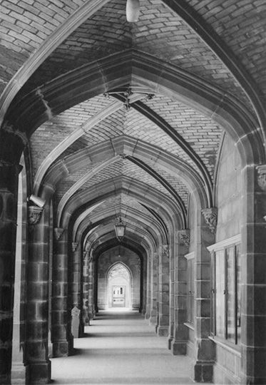 photo taken at one end of an empty cloister