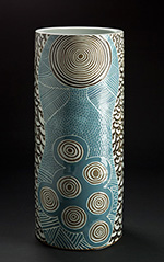 glazed stoneware pot covered with Indigenous artwork