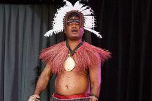 Man in tribal attire singing