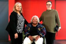 Group shot with three women, one in a wheel chair