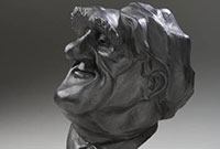 Painted plaster sculpture depicting a caricature of a man