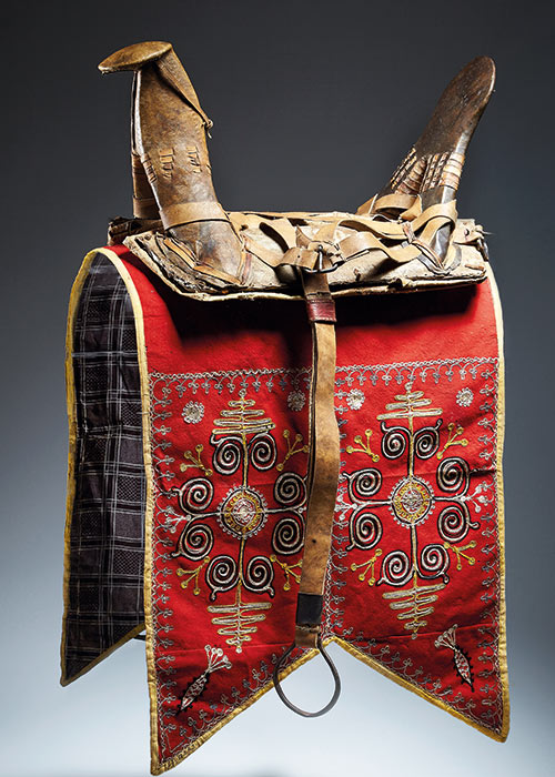 A saddle and saddlecloth with harness straps made from wood, leather, felted wool, wool embroidery - click to view larger image