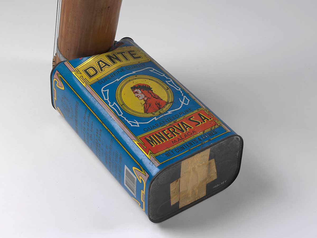 A blue tin with 'DANTE' written at the top and 'MINERVA SA' at the base. An image of a man dressed in red appears in a central circle on the tin. Bamboo tubing extends from one end.