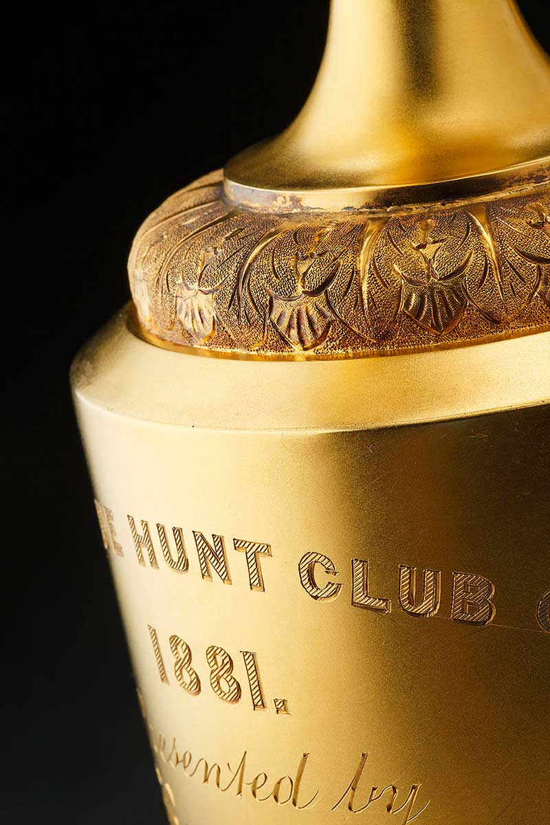 Detail view of gold trophy showing engraved text that reads: HUNT CLUB 1881. - click to view larger image