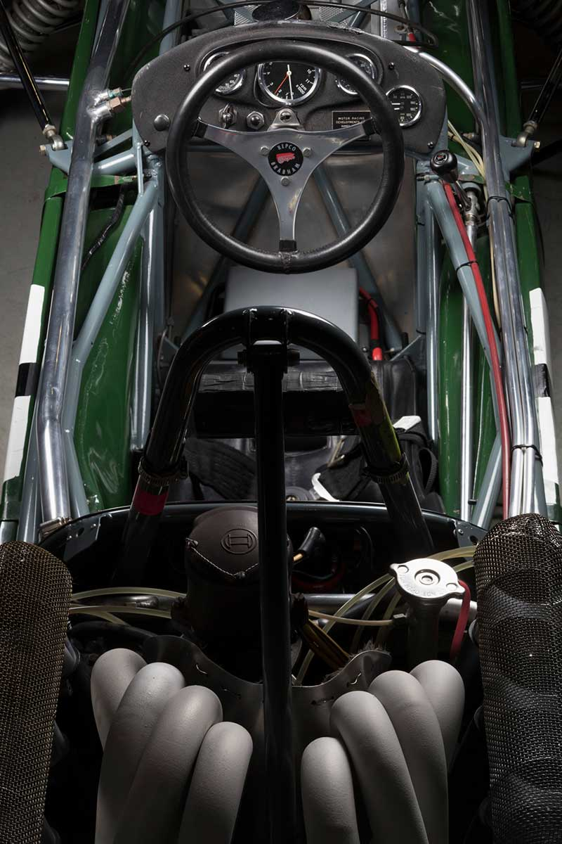View of racing car cabin from above showing seat and steering wheel. - click to view larger image