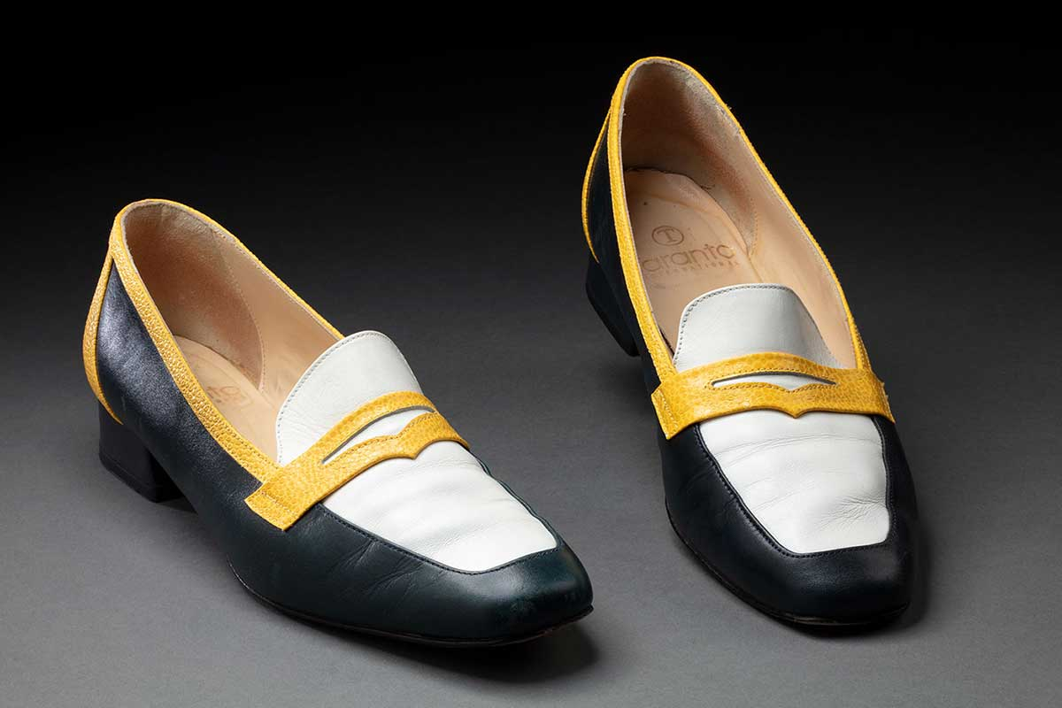 Pair of navy, yellow and white shoes belonging to Jackie Huggins. - click to view larger image