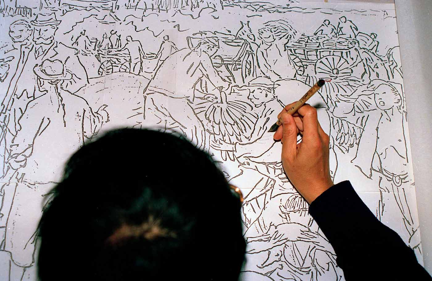 Mo Xiangyi prepares some preliminary sketches for the scroll.