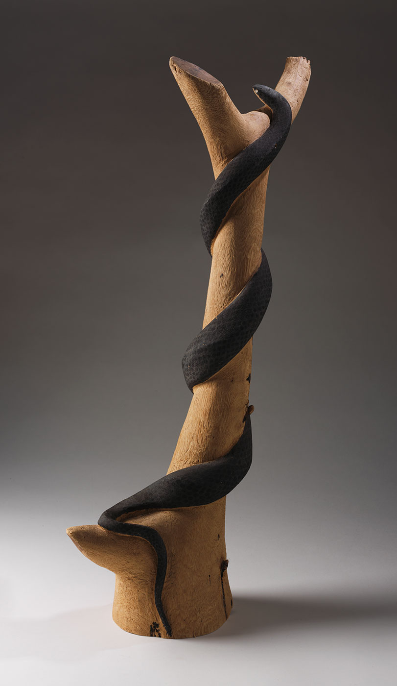 Carved snake 1973 made by Clifford Possum Tjapaltjarri. - click to view larger image