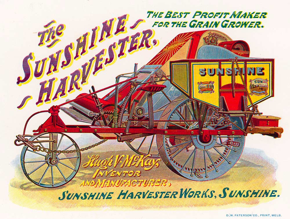 A rectangular colour advertising poster for a Sunshine Harvester machine. The poster has text at the top and bottom with a colour illustration of a decorated three wheeled machine with a wood and metal triangular shaped body in the centre. The text at the top reads 'The Sunshine Harvester, the best profit maker for the grain grower.' The text at the bottom reads 'Hugh V. McKay, Inventor and manufacturer. Sunshine Harvester Works, Sunshine.'  In the bottom right corner the poster is attributed to 'D.W. Paterson Co. Print, Melb.'.