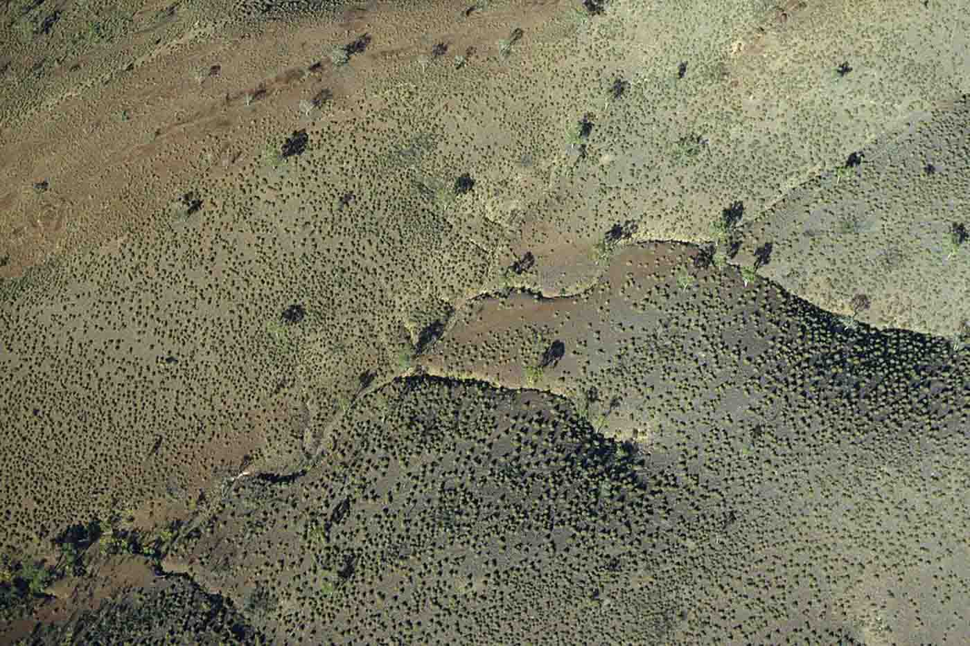 Aerial view of a landscape with foothills. - click to view larger image