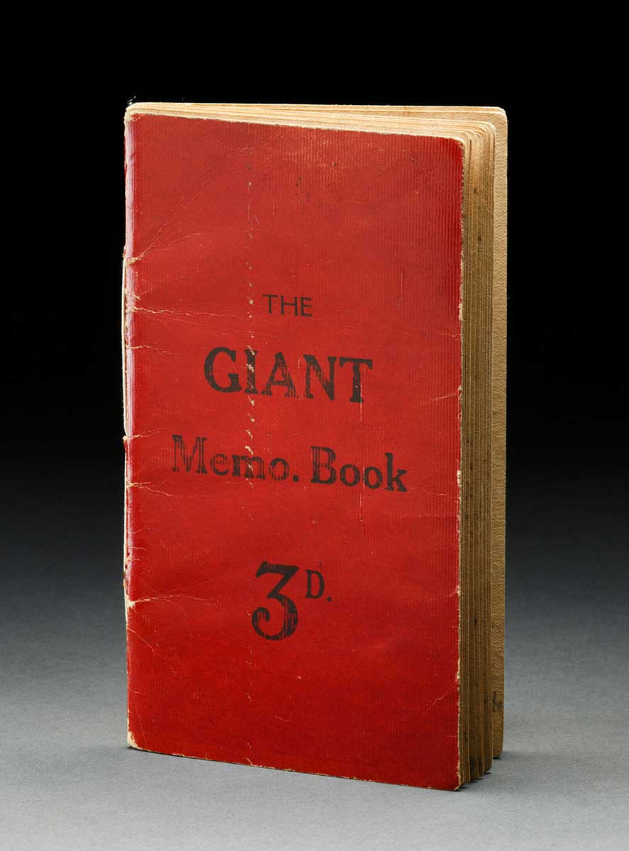 A red cardboard covered diary. The cover reads 'THE  GIANT  Memo. Book  3D.' - click to view larger image