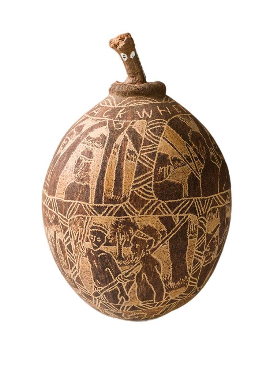 An engraved boab nut decorated with three rows of inscribed scenes in a series of frames. - click to view larger image