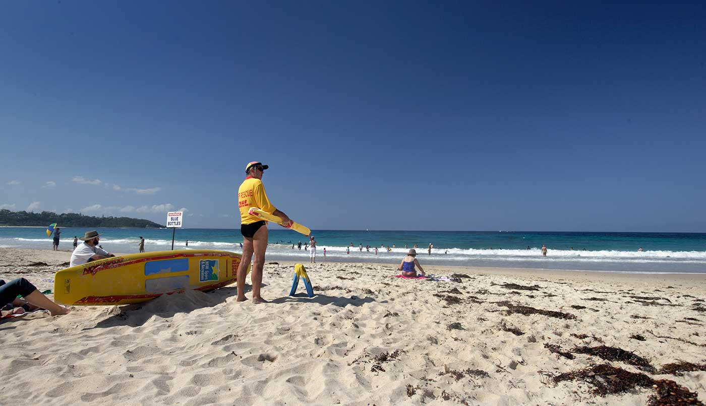 Surf lifesaver patrolling the beach at Mollymook, New South Wales, 2006.