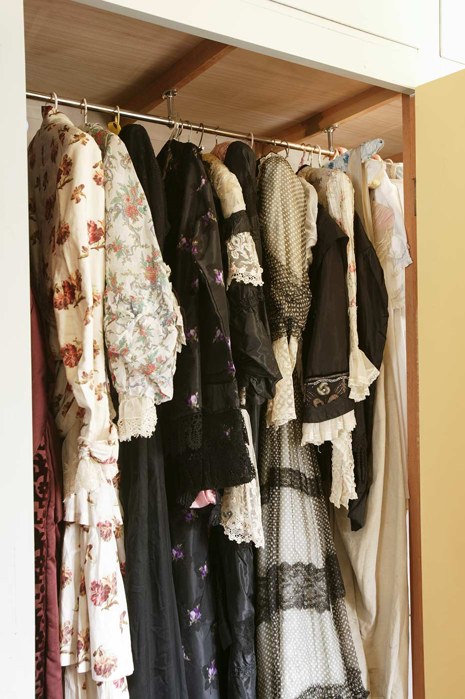 19th and 20th century dresses stored in a wardrobe. - click to view larger image