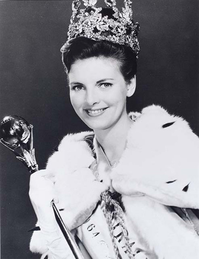 Miss Australia 1964, Jan Taylor holding a sceptre, wearing the crown, robe and long white gloves - click to view larger image