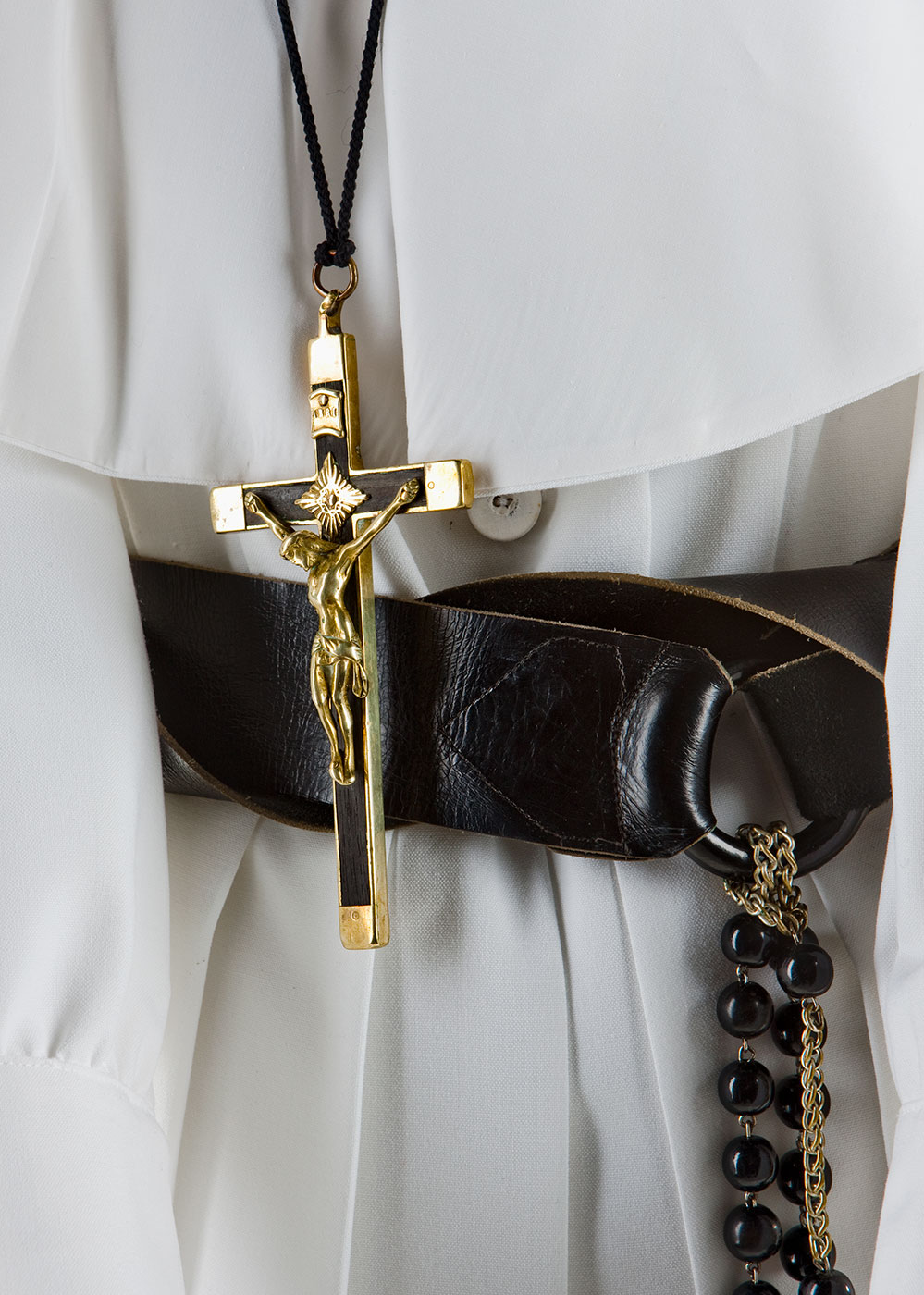 Habit featuring crucifix pendant with a gold Jesus, leather belt and rosary beads attached. - click to view larger image